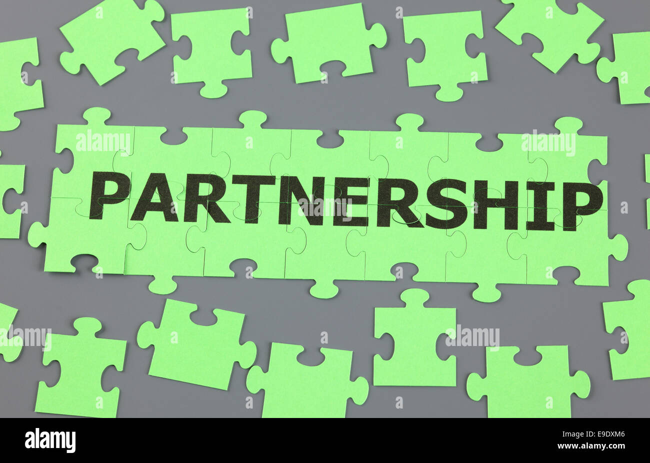 Jigsaw puzzle with word 'Partnership'. - Stock Image
