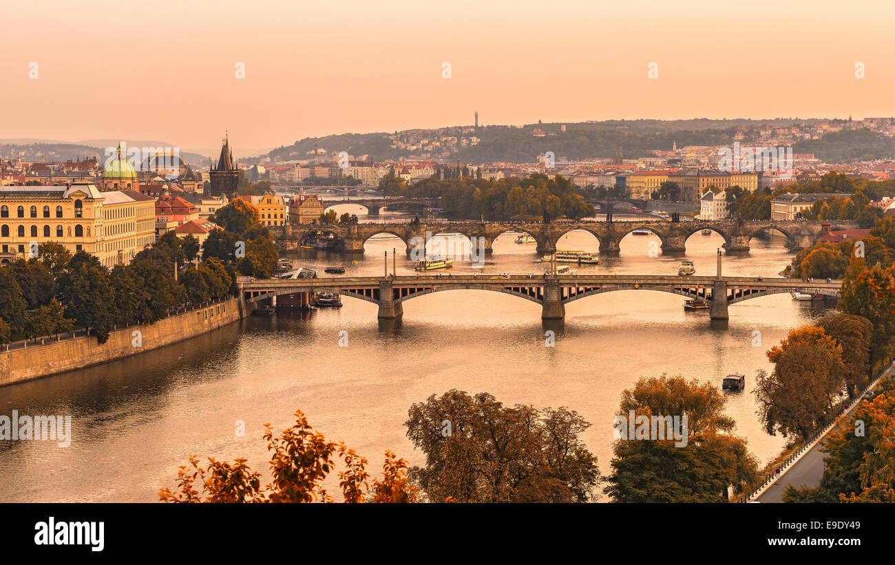 Old bridges of Prague at sunset from Letna park - Stock Image