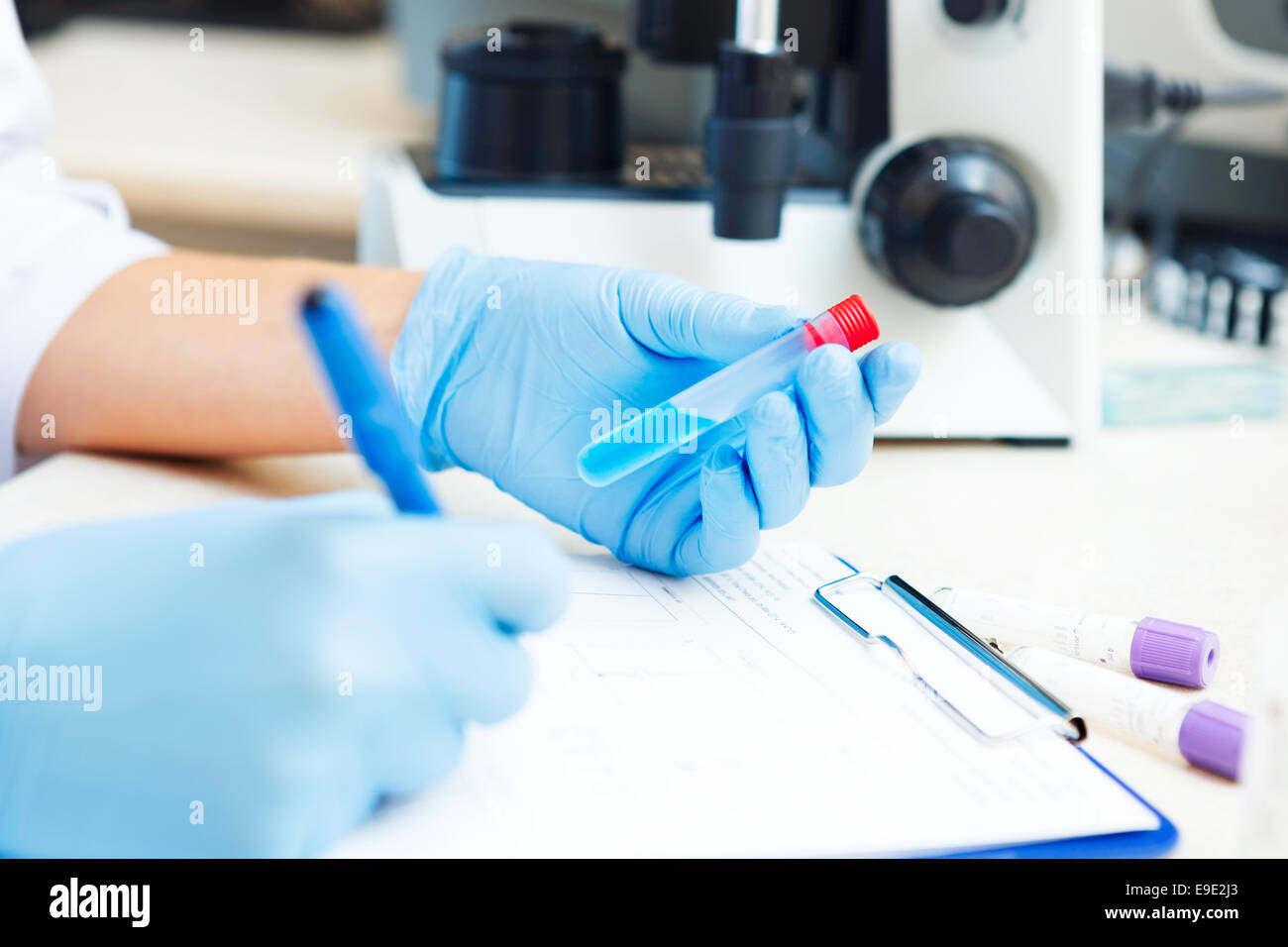 Closeup of a scientist working with samples in lab. - Stock Image