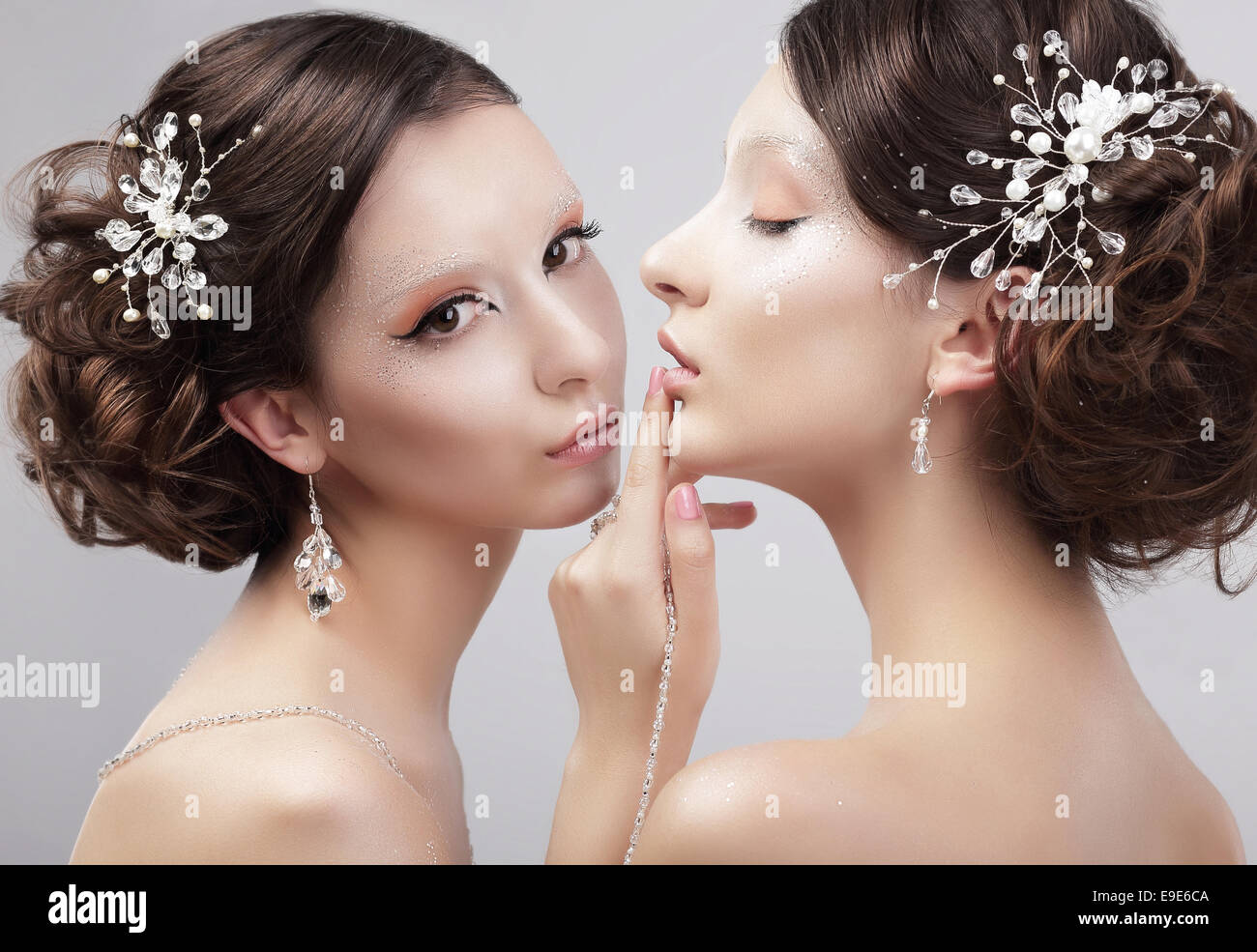 Sensuality. Two Women Fashion Models with Trendy Make-up - Stock Image