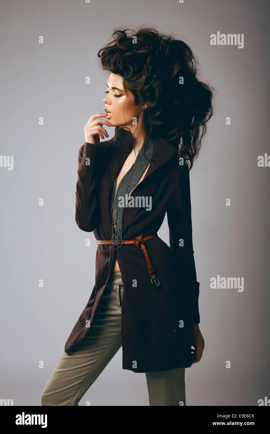 Vogue Style. Classy Fashion Model in Stylish Brown Jacket and Pants - Stock Image