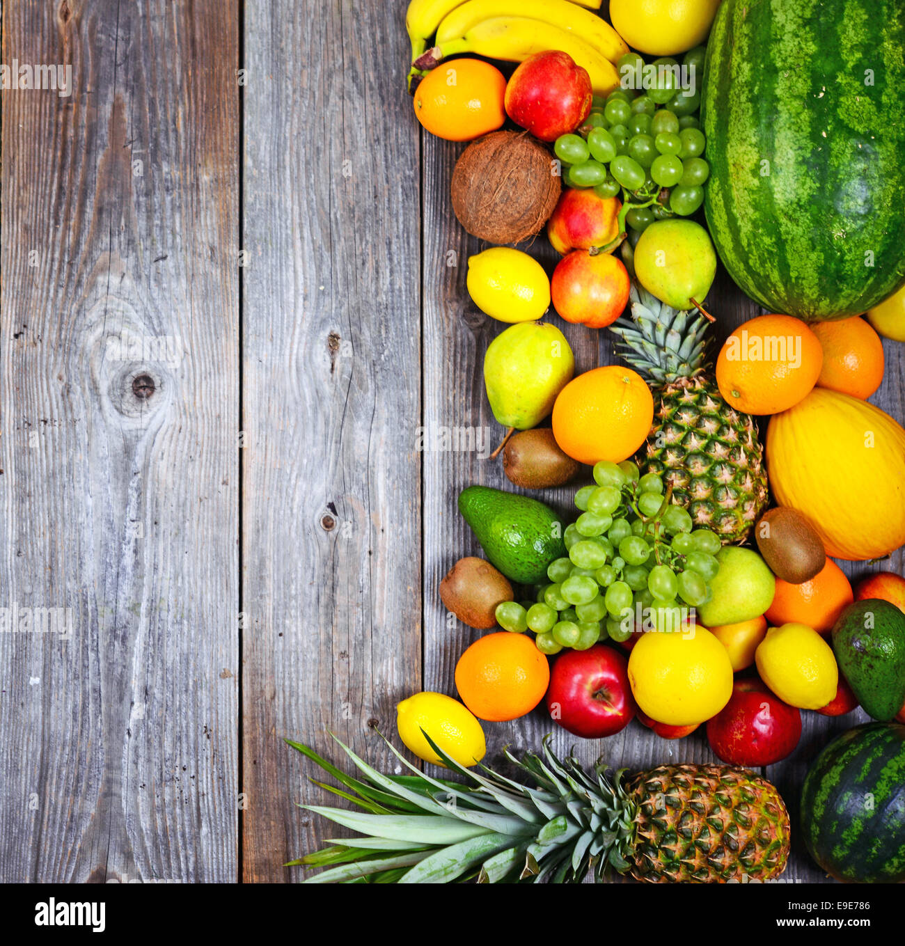 Huge group of fresh colorful fruit on wooden background ...