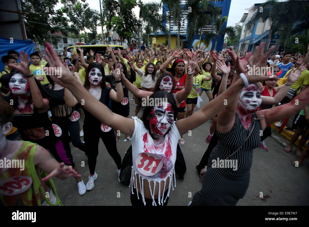 People wearing zombie make-up and costumes dance along with other participants during a Zombie Zumba Party in Mandaluyong City the Philippines Oct. 26 ...  sc 1 st  Alamy & Mandaluyong Philippines. 26th Oct 2014. People wearing zombie ...