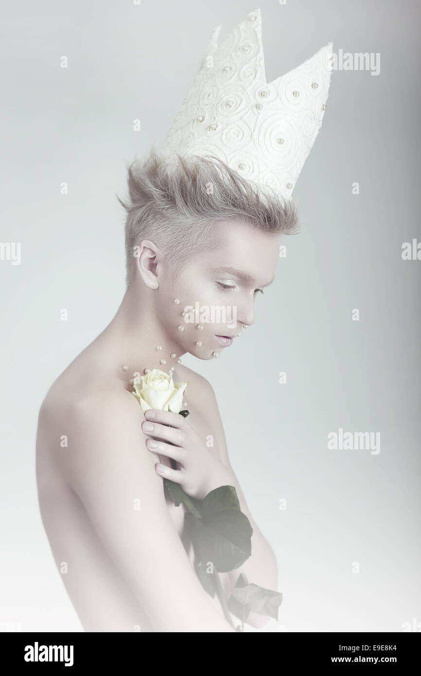Creative Concept. Man in Crown with Flowers - Stock Image