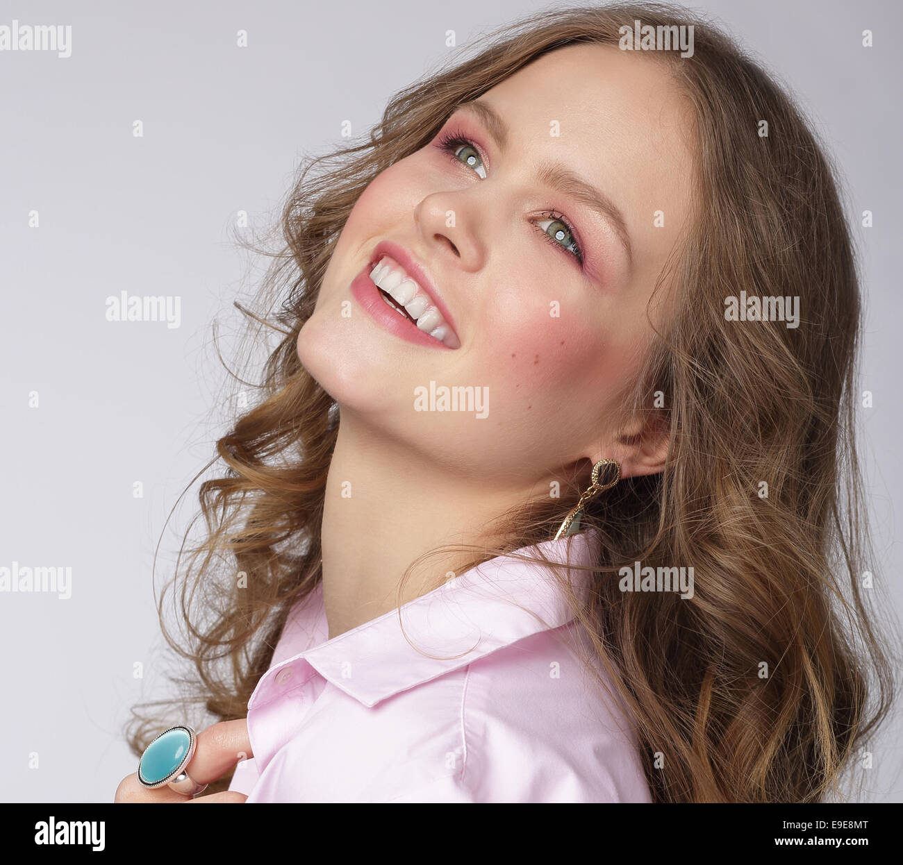 Positive Emotions. Delighted Attractive Woman Looking Up - Stock Image