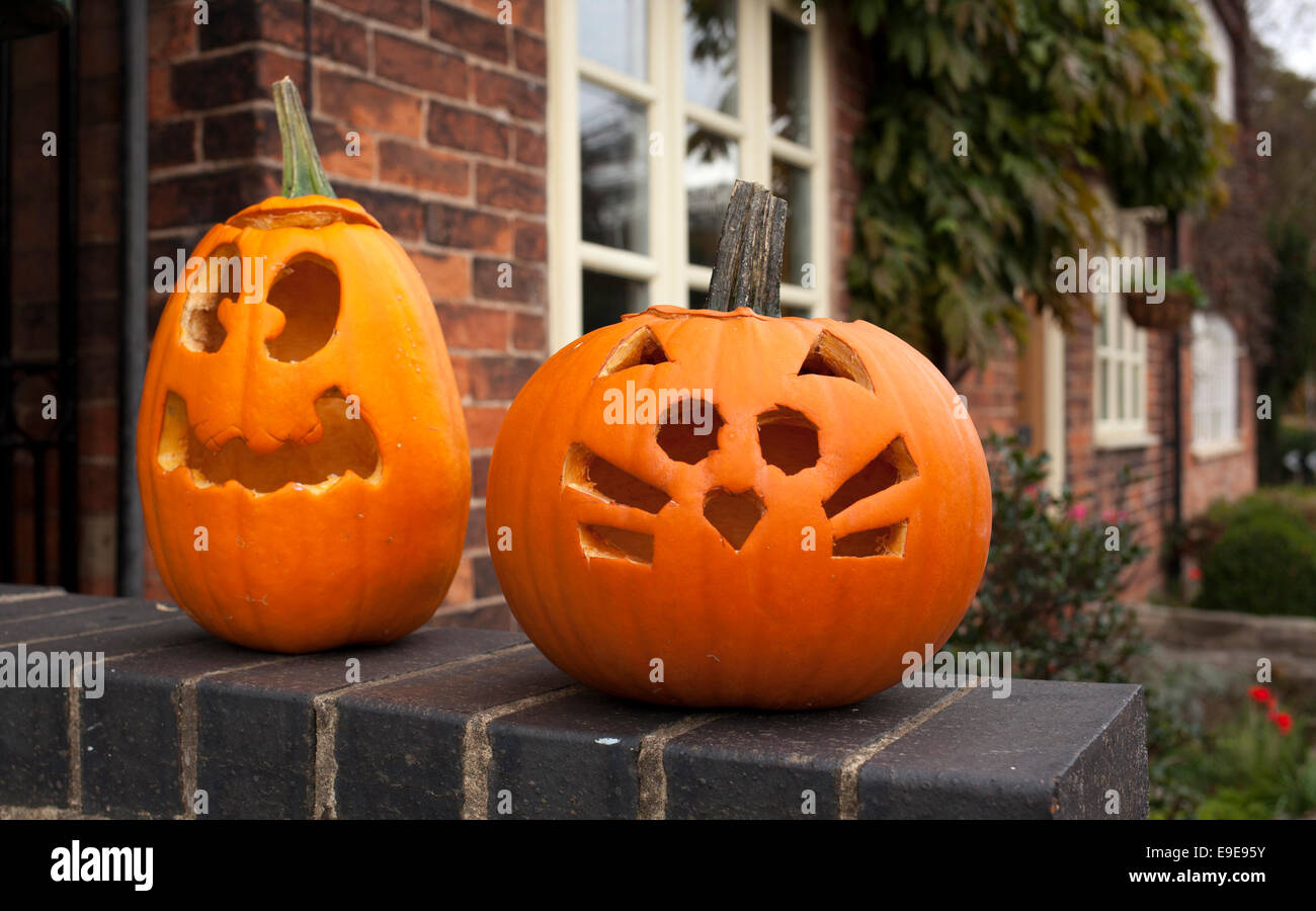 Halloween pumpkins left outside cottages in the village of Woodborough, England, U.K. - Stock Image