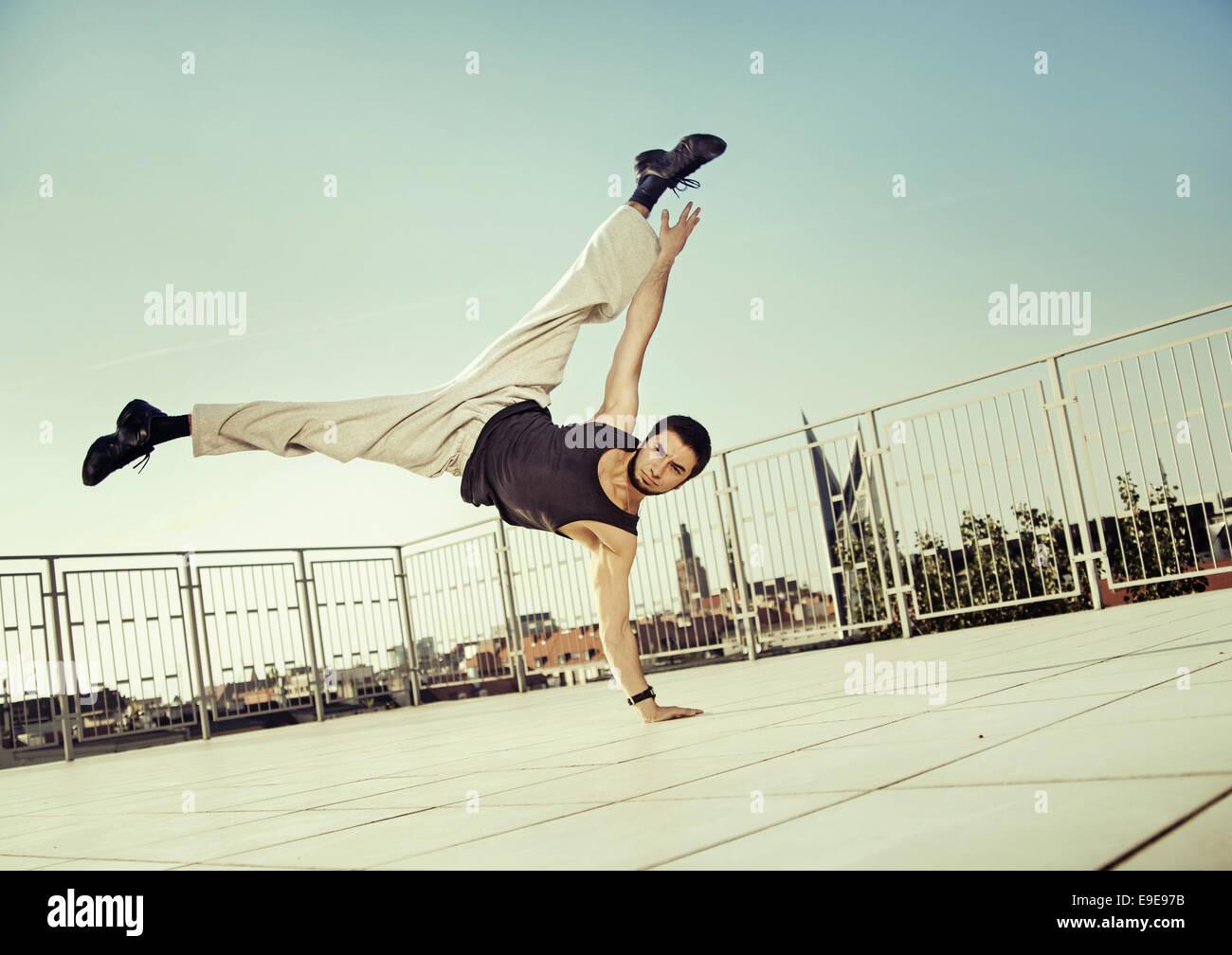 Strong guy doing hard exercises - Stock Image