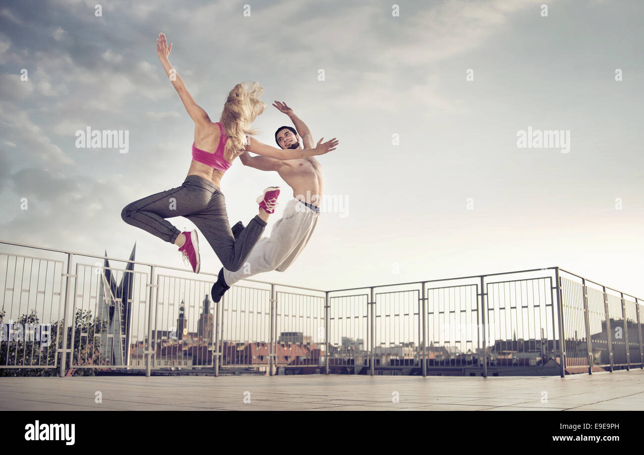 Athletic couple during the hard jump training - Stock Image