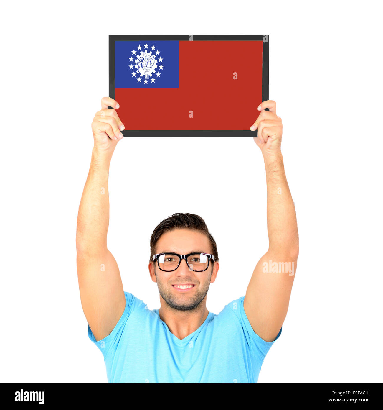 Portrait of a young casual man holding up board with National flag of Myanmar Stock Photo