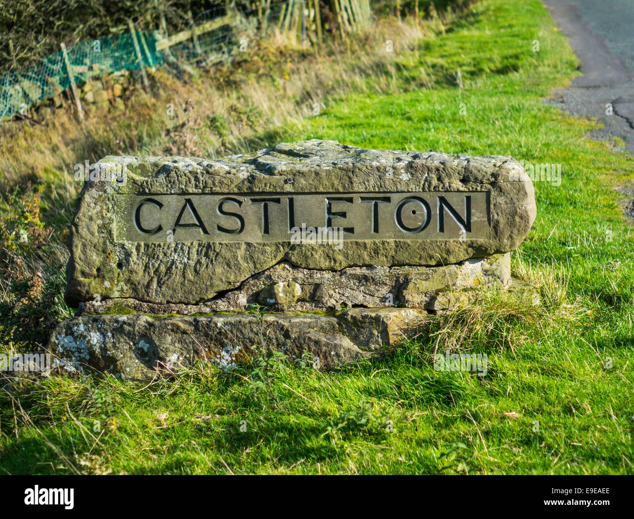 A carved stone sign for the village of Castleton North Yorkshire England UK - Stock Image