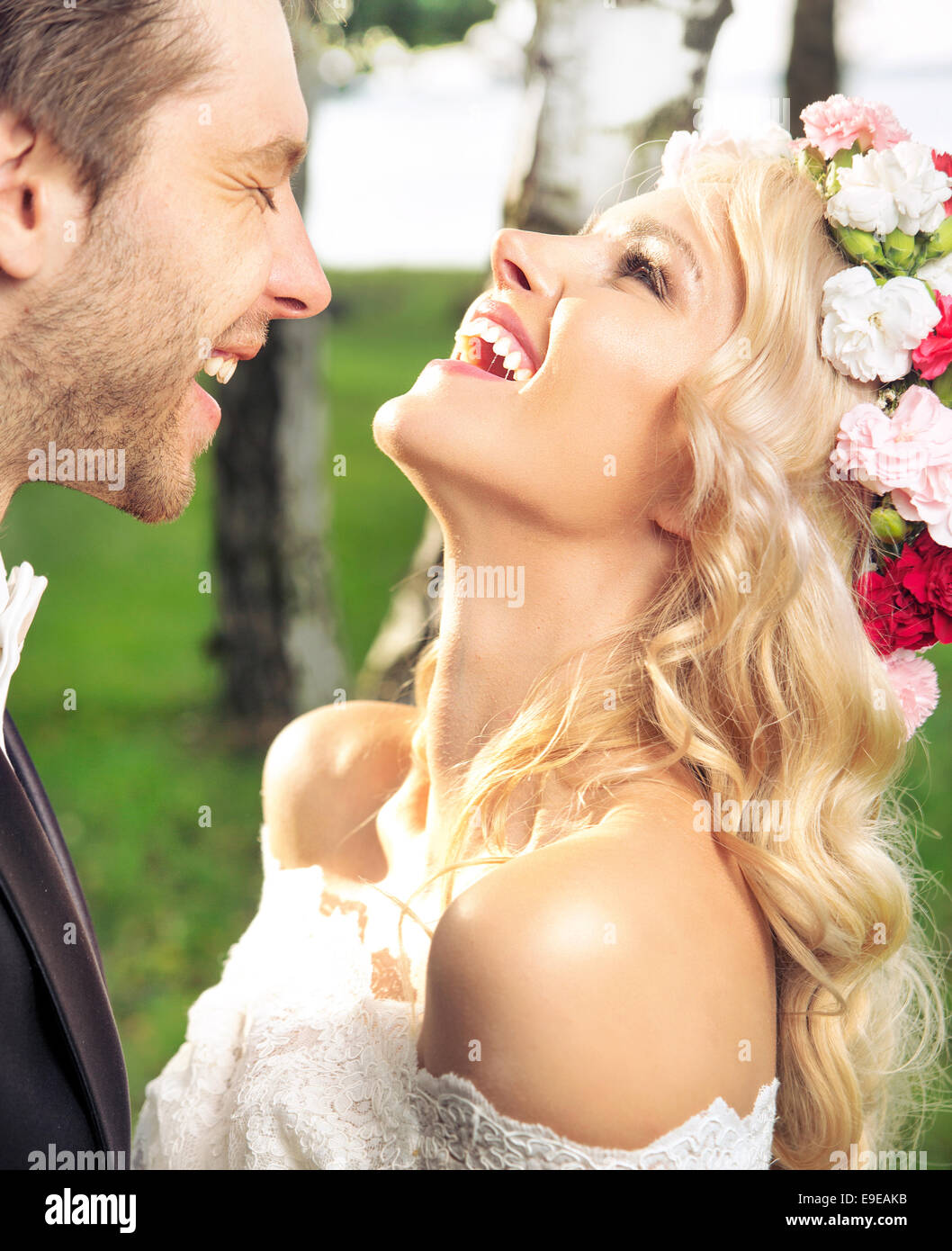 Portrait of the happy just married couple - Stock Image
