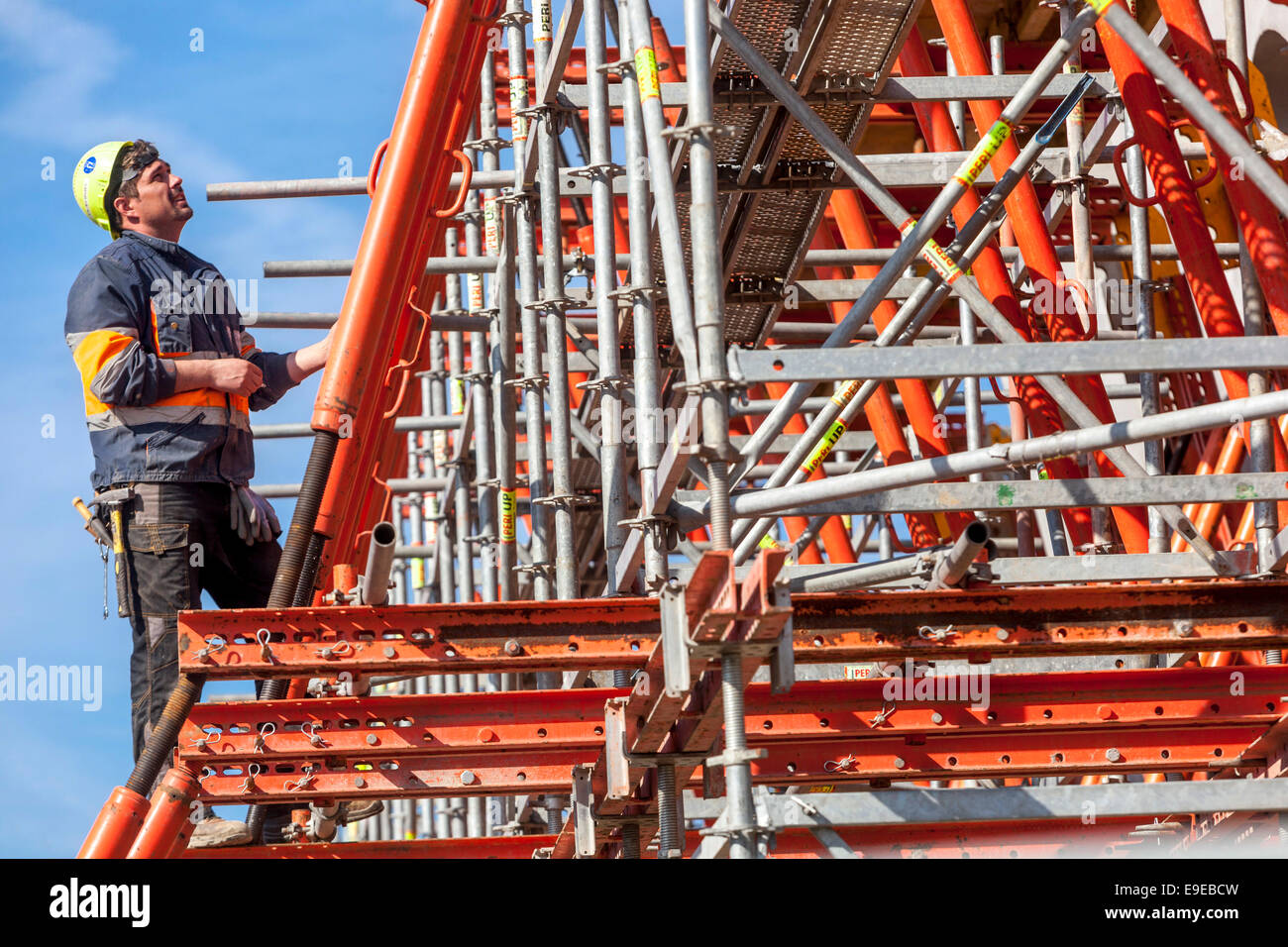 Scaffolding and construction of building - Stock Image