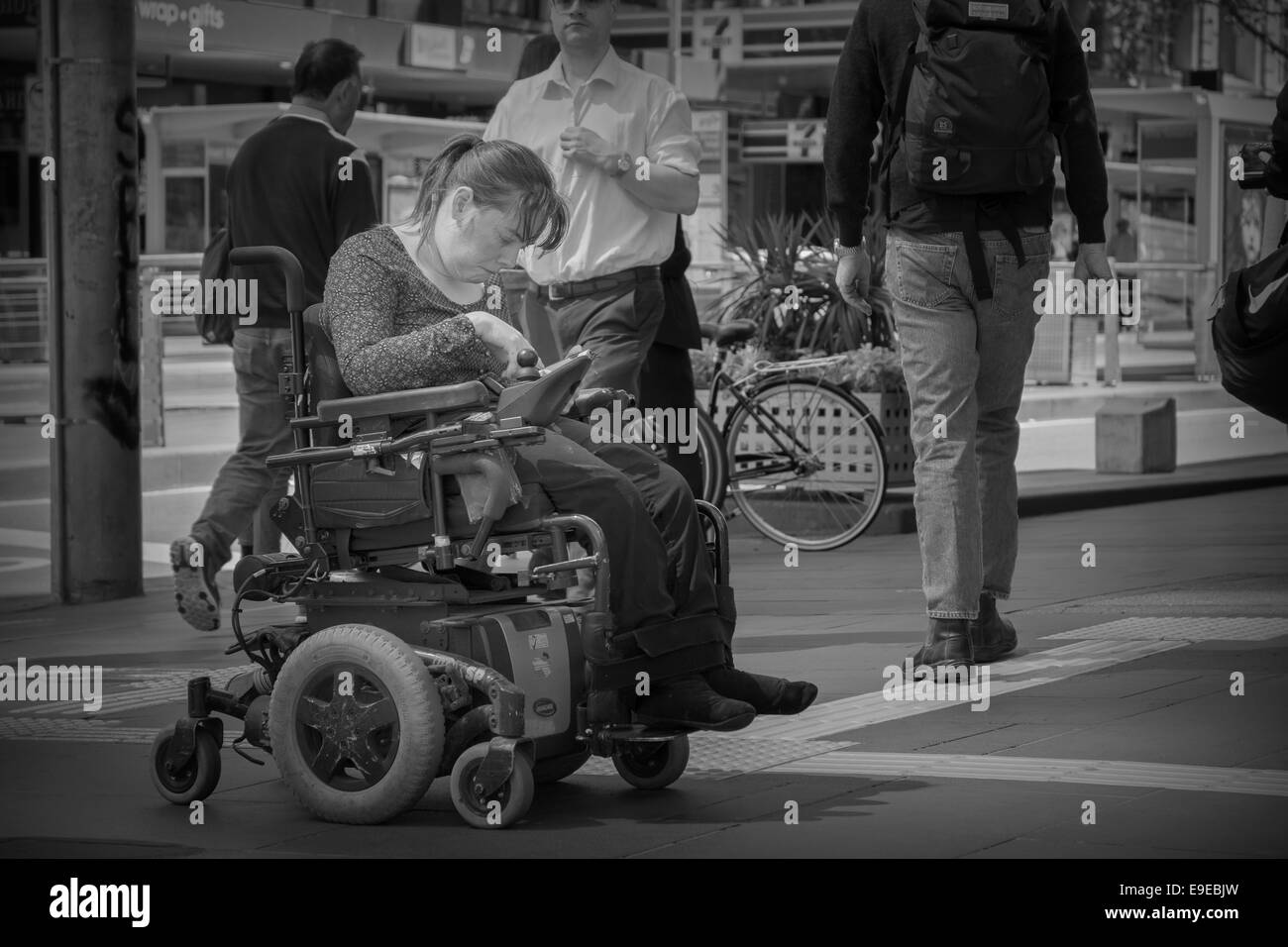Disabled Woman In Electric Wheelchair - Stock Image