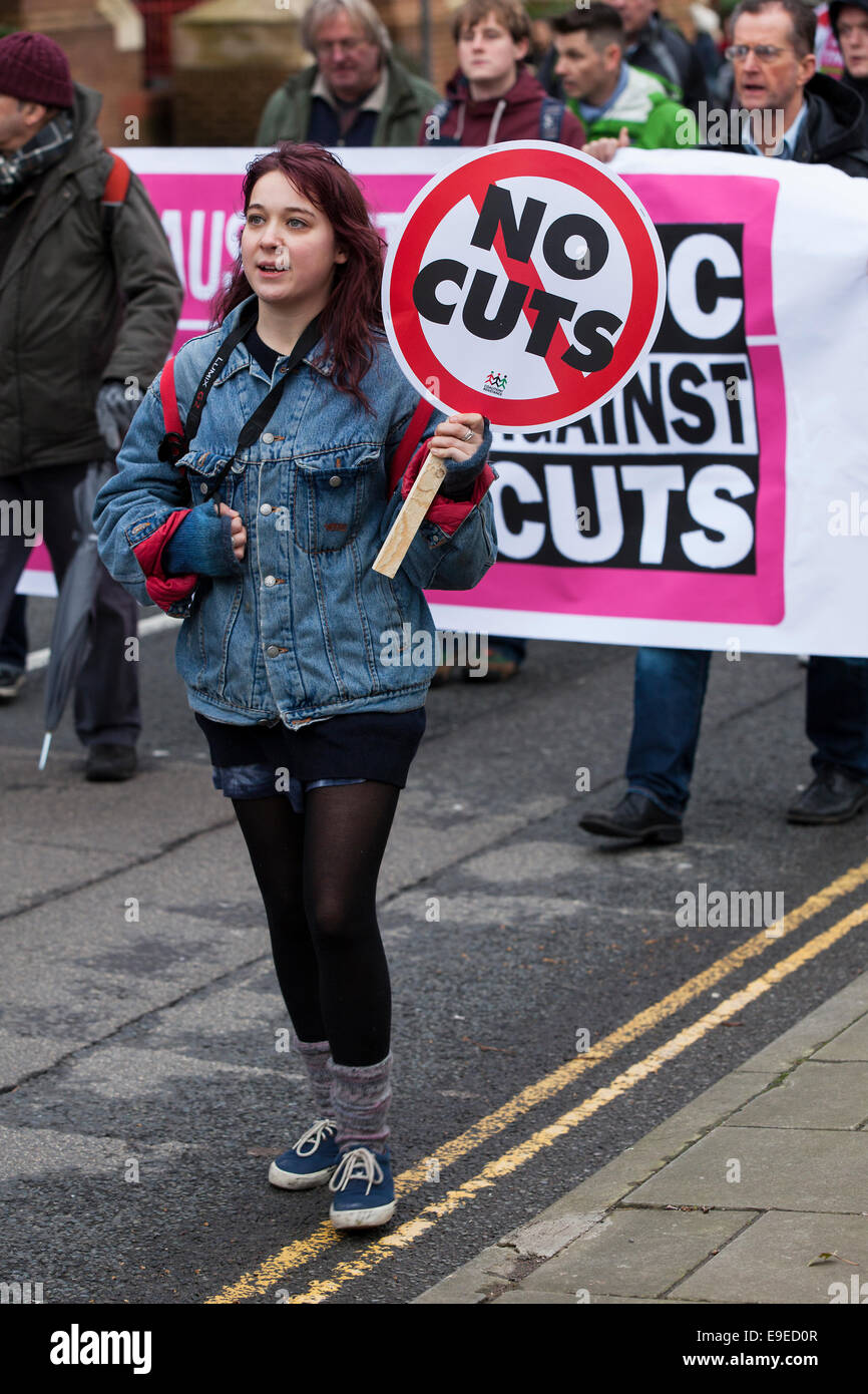 A woman holds a placard reading 'no cuts'  at an anti-austerity protest in Bristol, UK Stock Photo