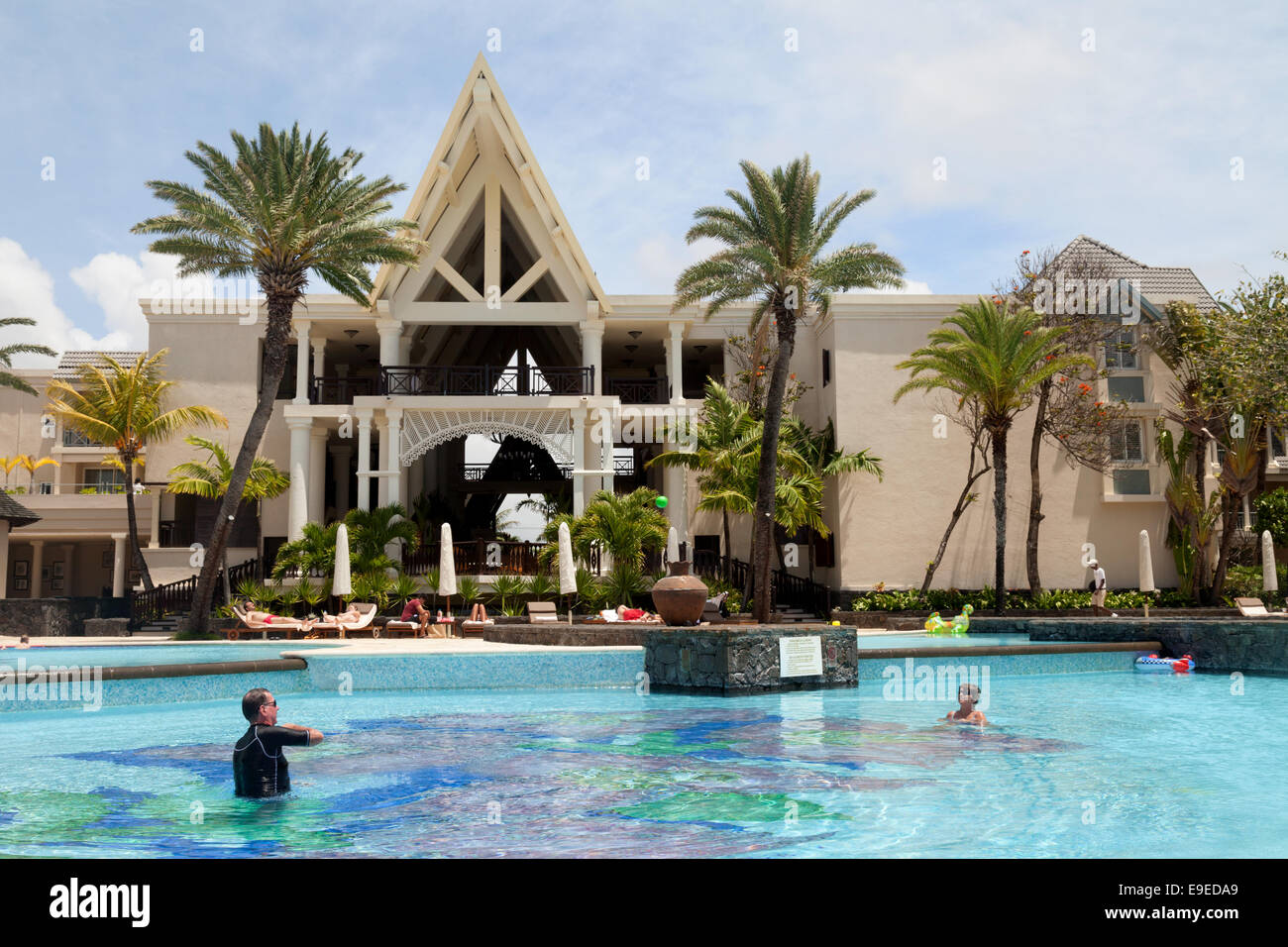 Hotel guests in the swimming pool in the 5 star luxury Residence Hotel, Belle Mare east Mauritius - Stock Image