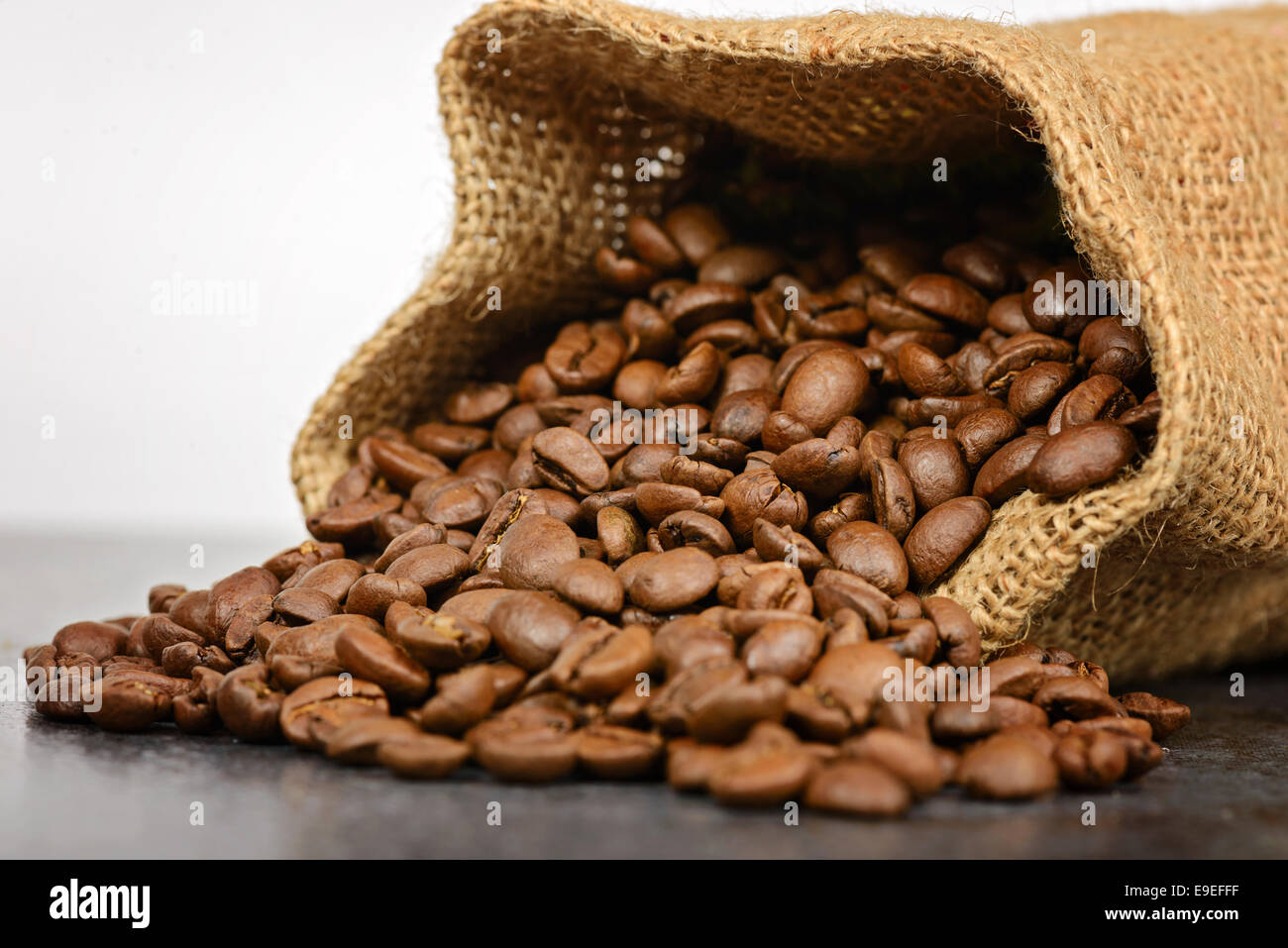 Studio shot of coffee beans in a bag - Stock Image