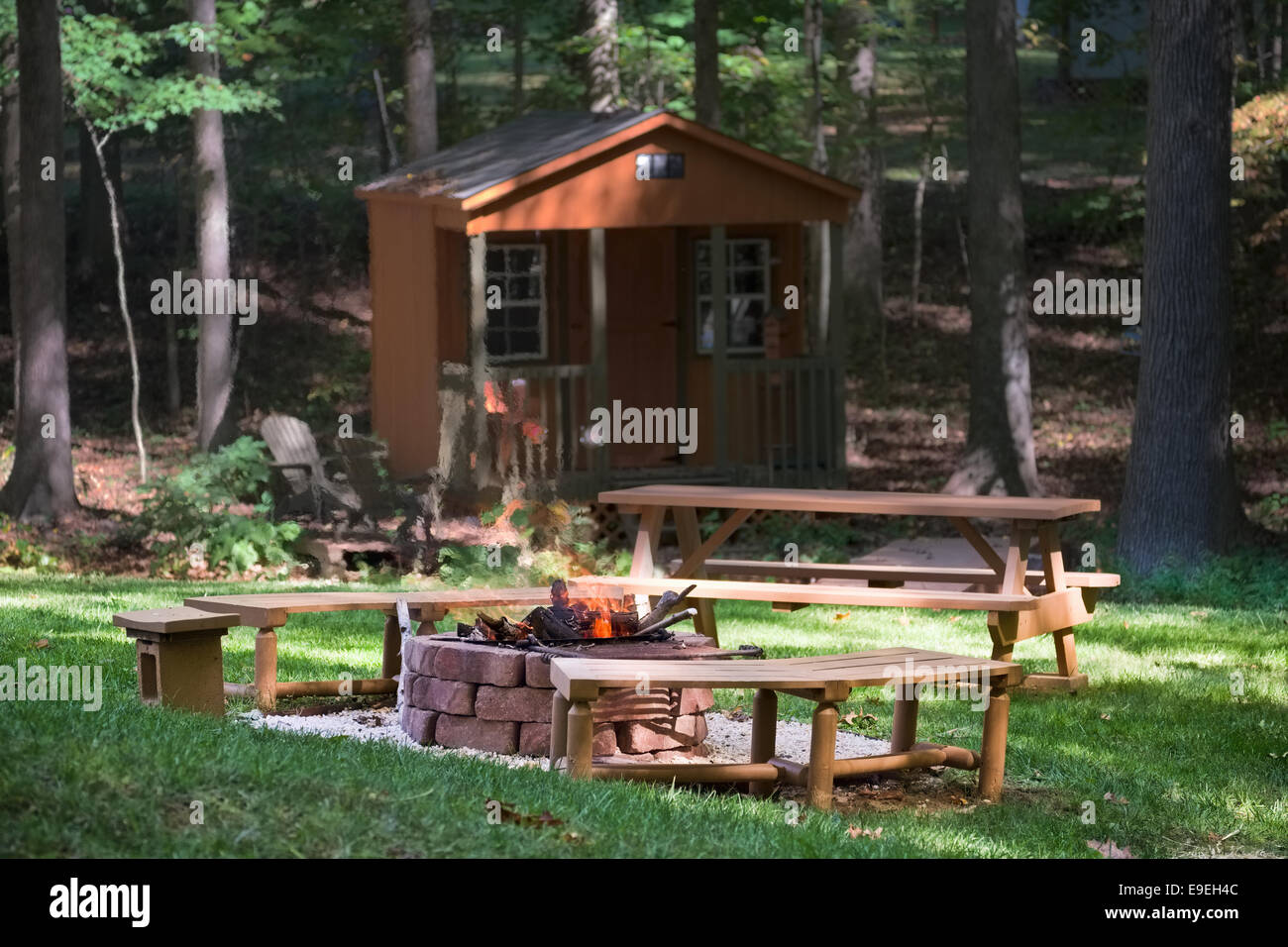 Backyard fire pit and picnic area - Stock Image