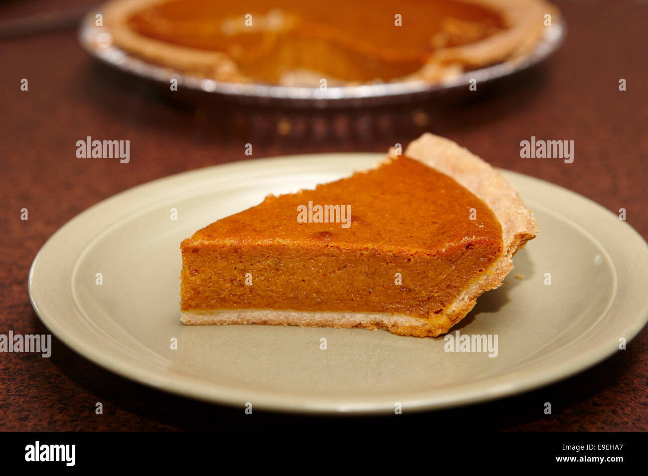slice of mass produced pumpkin pie - Stock Image