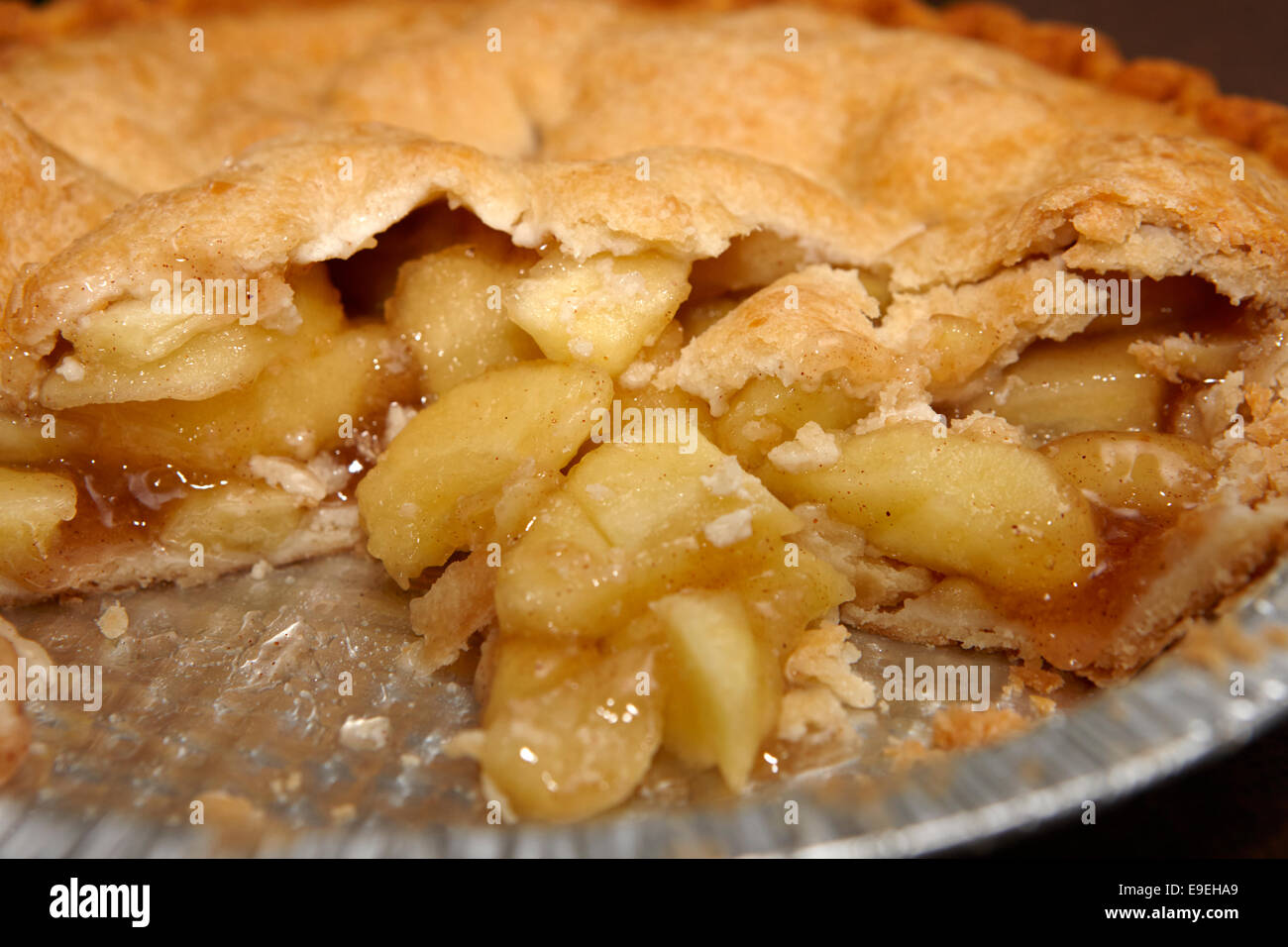 large chunks of apple in mass produced apple pie - Stock Image