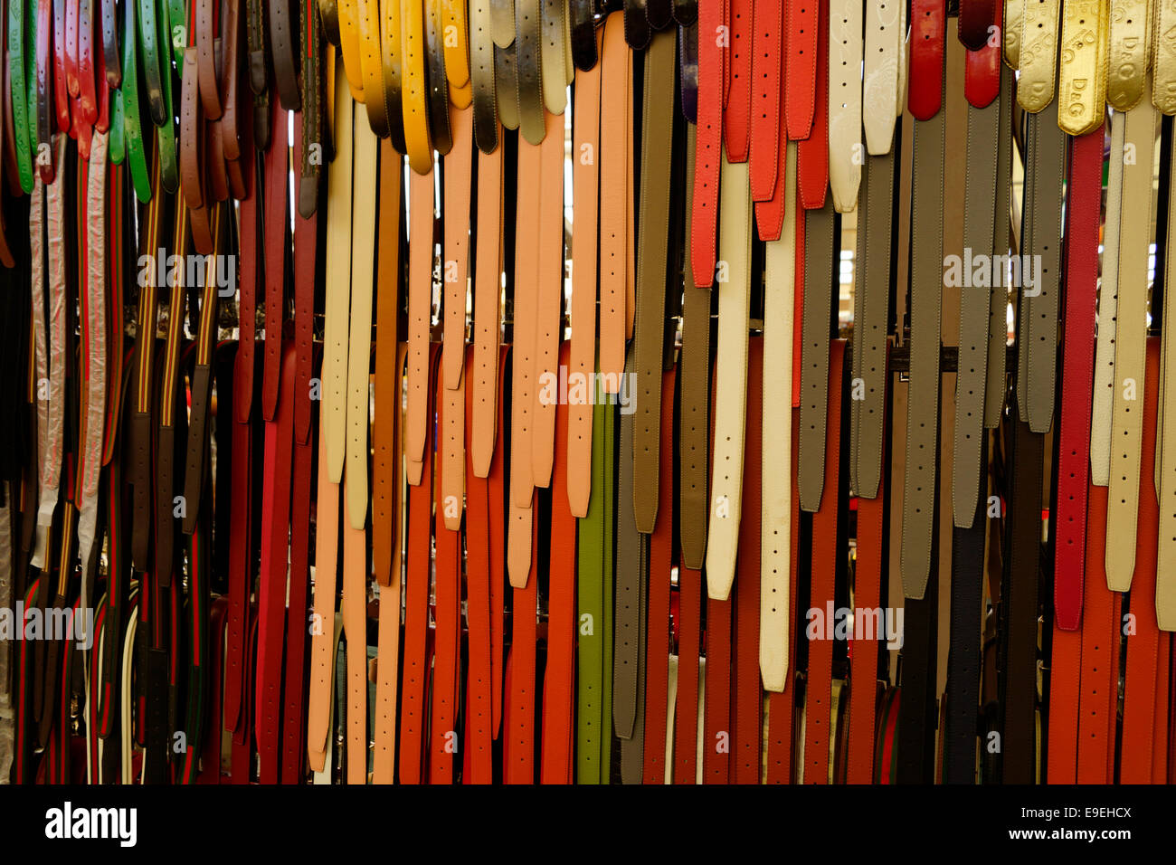 Belts of many colours and sizes - Stock Image