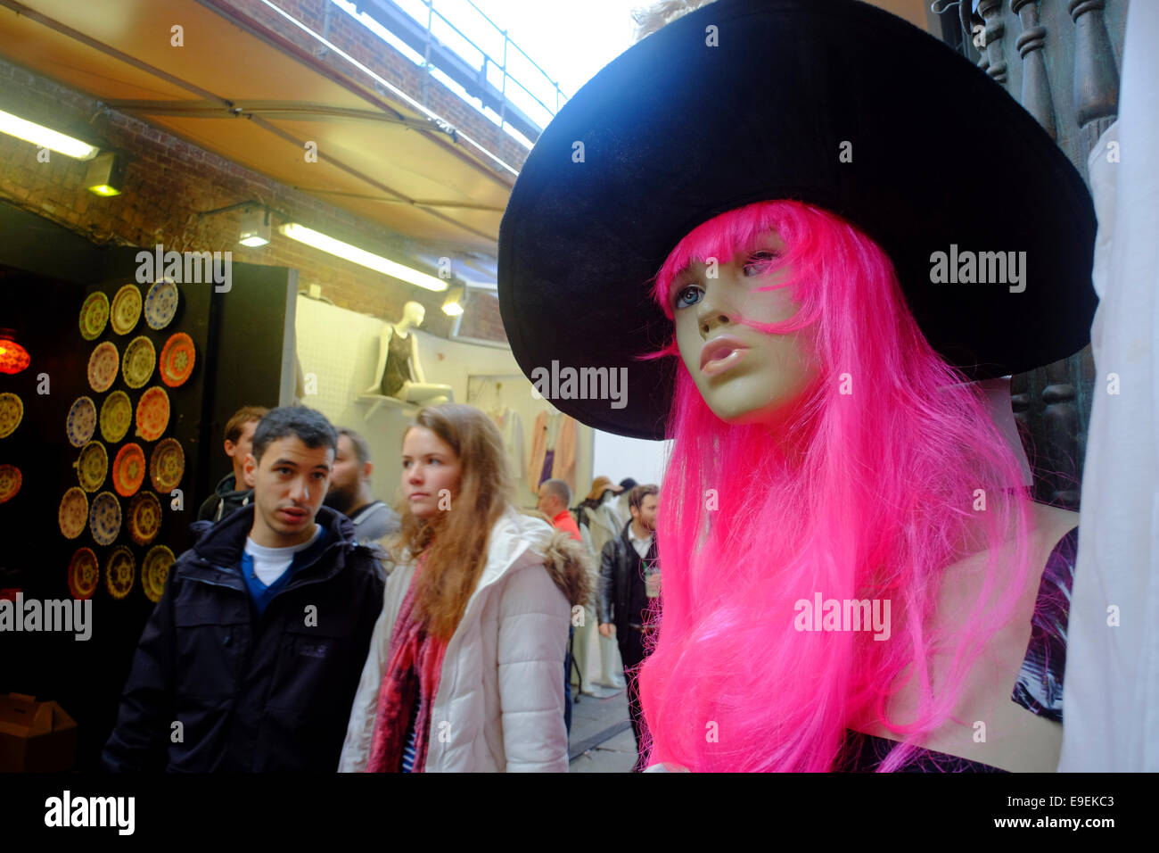 pink wig & witched hat on manikin at Camden Market, London, UK - Stock Image