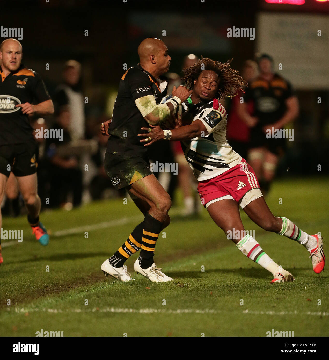 High Wycombe, UK. 26th Oct, 2014. European Rugby Champions Cup. Wasps versus Harlequins. Marland Yarde tackles Tom - Stock Image