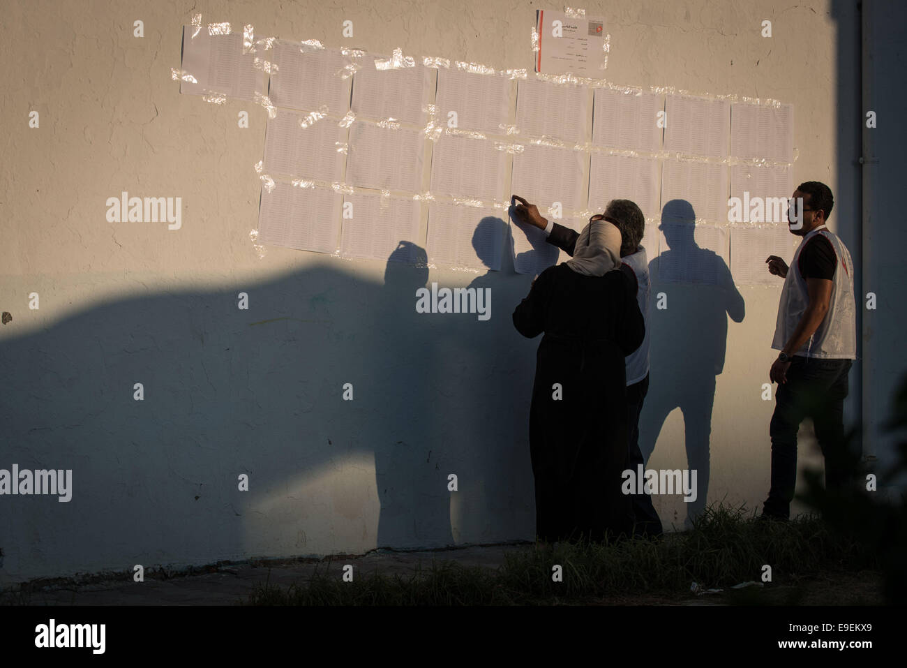 Tunis, Tunisia. 26th Oct, 2014. Electoral workers check information at a polling station in Tunis, capital of Tunisia, - Stock Image