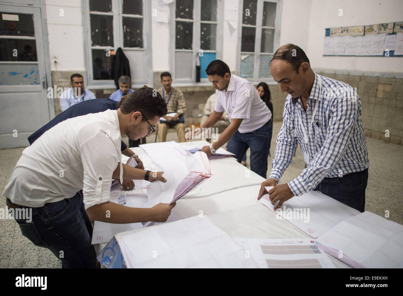 Tunis, Tunisia. 26th Oct, 2014. Electoral workers count ballots at a polling station in Tunis, capital of Tunisia, - Stock Image