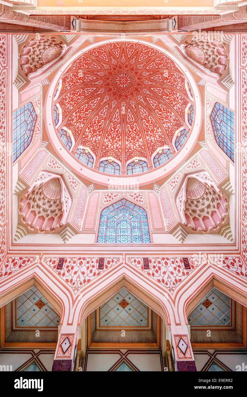 Dome of the Masjid Putra Mosque aka the Pink Mosque in Putrajaya Malaysia. Modern (1999) Sunni Islamic architecture. - Stock Image