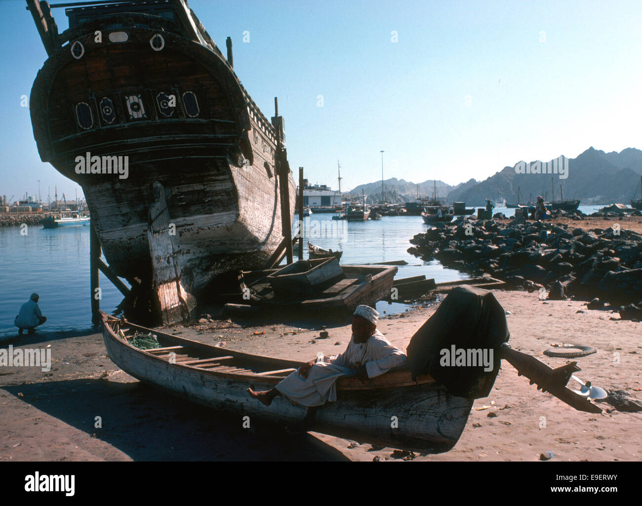 Change in Muttrah, ancient baghala and an outboard motor on a fishing boat, Oman 1975 - Stock Image