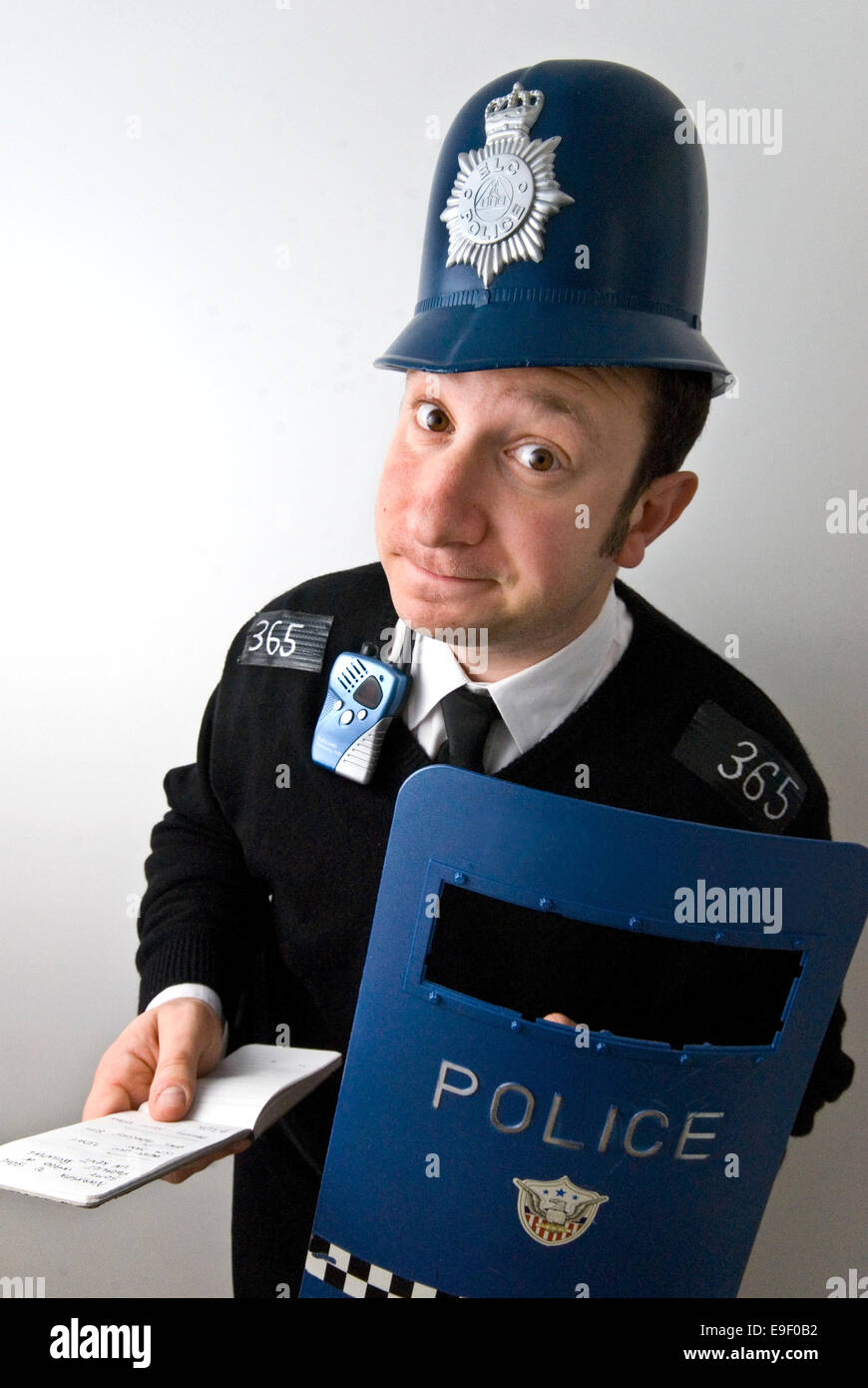 93548a59f6 a man dressed in a silly fancy dress costume as an english policeman ...