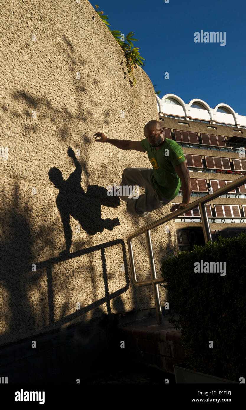 Parkour traceur and shadow - Stock Image
