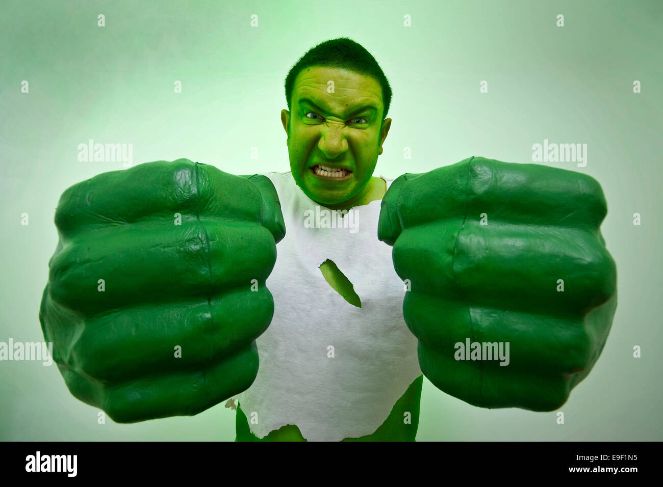 a man dressed in fancy dress comedy costume as the incredible hulk with giant green hands and ripped t shirt  sc 1 st  Alamy & a man dressed in fancy dress comedy costume as the incredible hulk ...