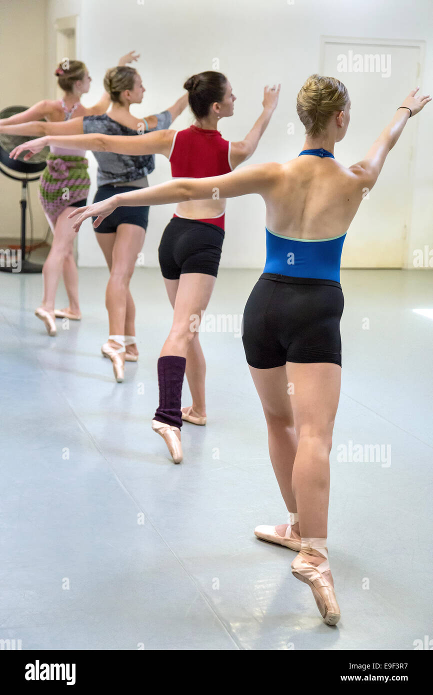 Four female dancers during a ballet rehearsal - Stock Image
