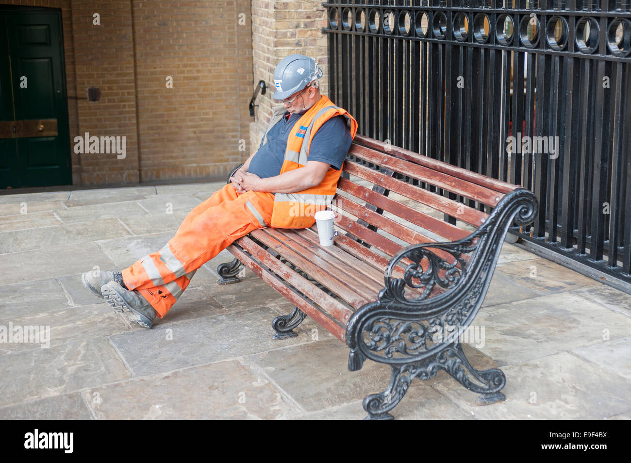 A construction worker having a nap, London, UK - Stock Image