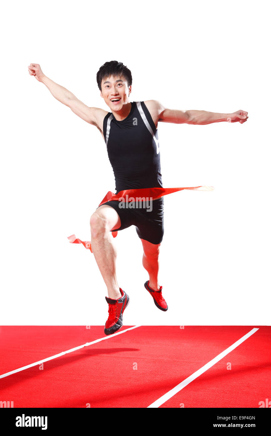 Male athlete running sprint Stock Photo