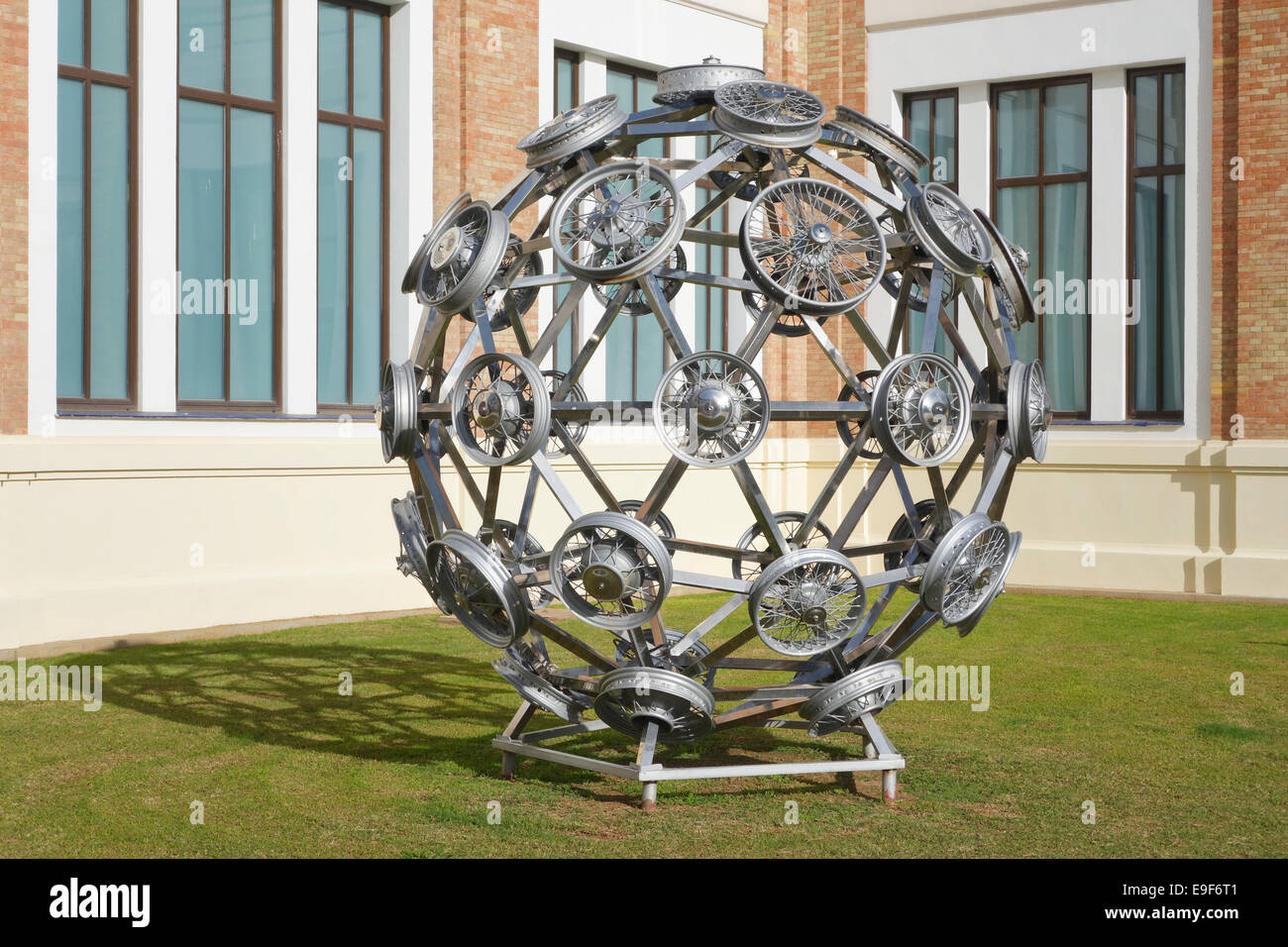 Sculpture of wheel rims at Car, Automobile Museum of Málaga, Andalusia, Spain. - Stock Image