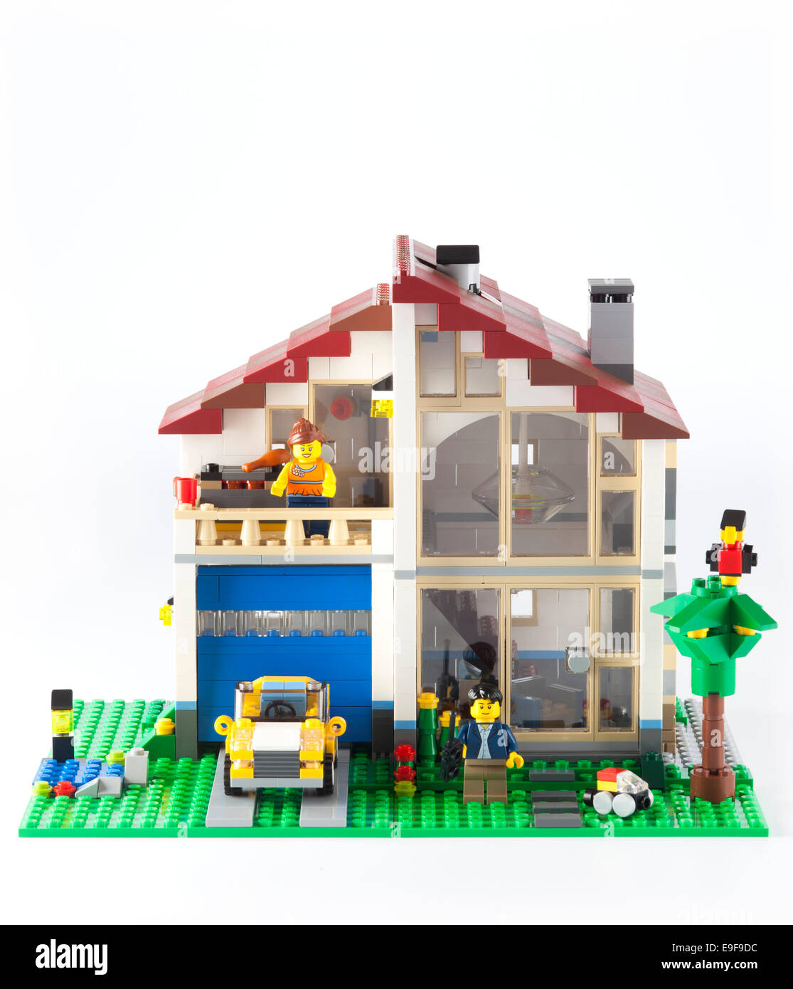 Tambov, Russian Federation - January 08, 2014 LEGO Family House with yellow car and couple minifigures on white Stock Photo