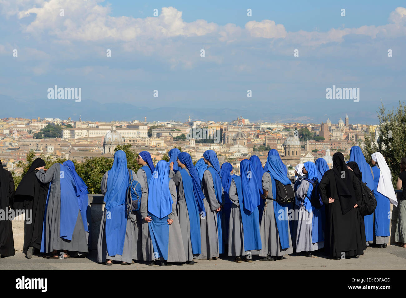 Rome. Italy. A group of nuns take in the view of the city from Piazza Garibaldi on the Gianicolo hill. - Stock Image