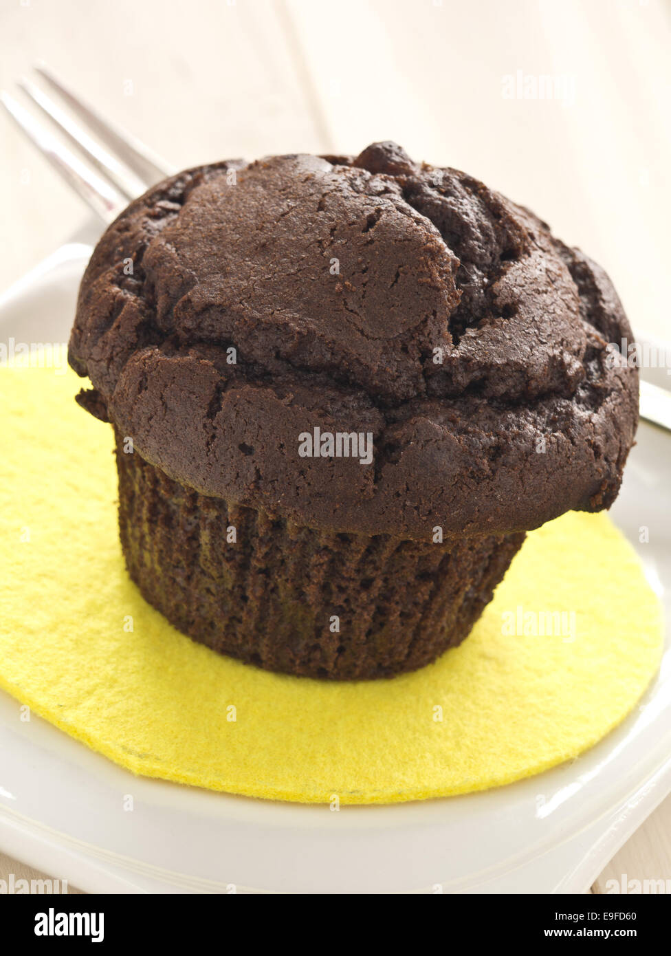 Chocolate muffin on a plate Stock Photo