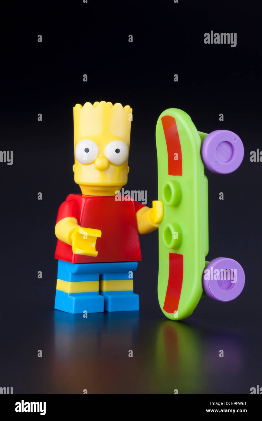 Tambov, Russian Federation - April 30, 2014 Lego Bart Simpson minifigure with skateboard on black background. Studio - Stock Image