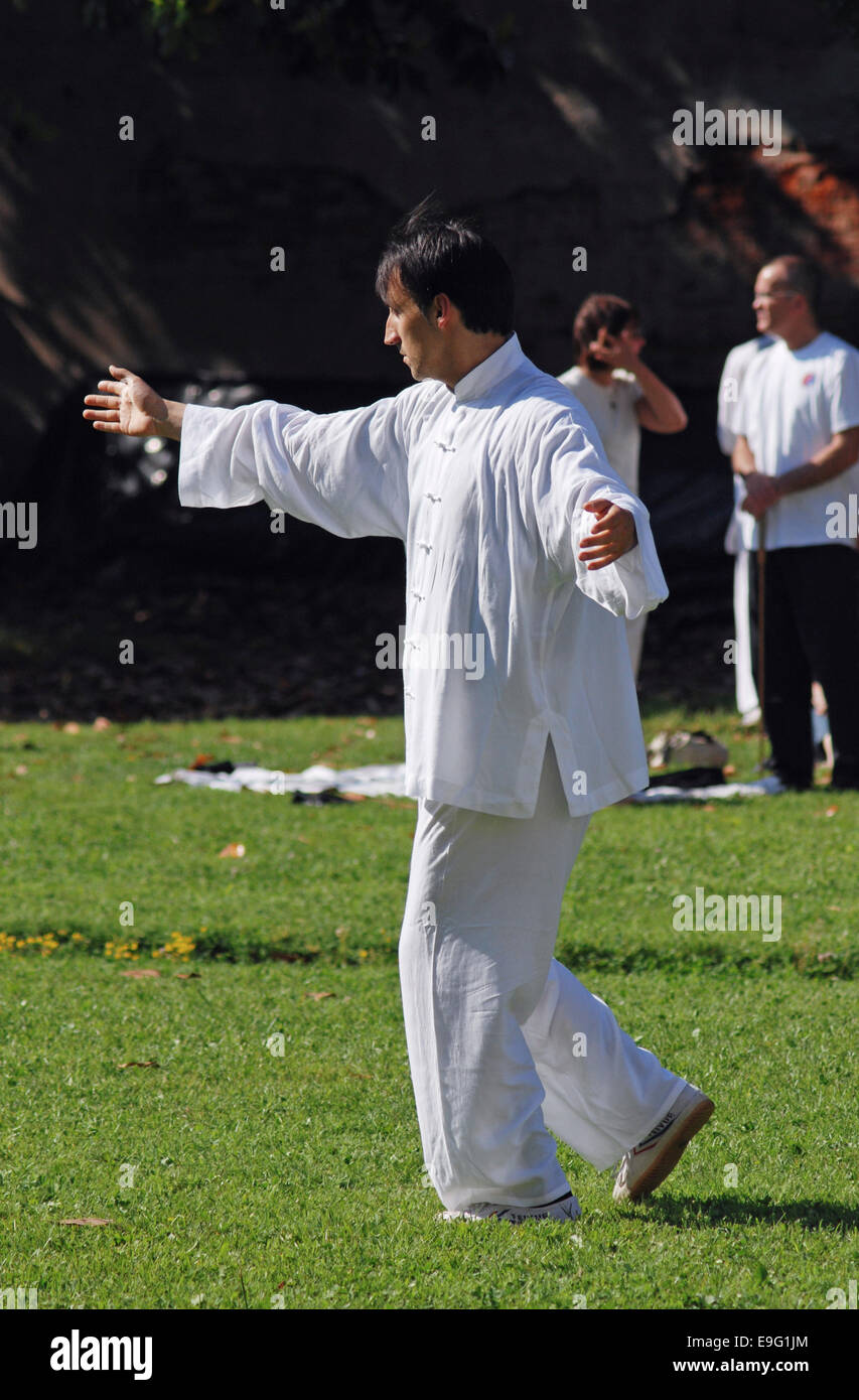 Tai chi exercising outdoors - Stock Image