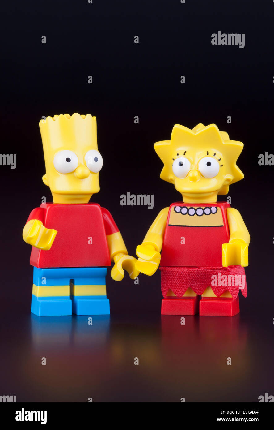 Tambov, Russian Federation - April 30, 2014 Lego Bart and Lisa Simpsons minifigures on black background. Studio - Stock Image