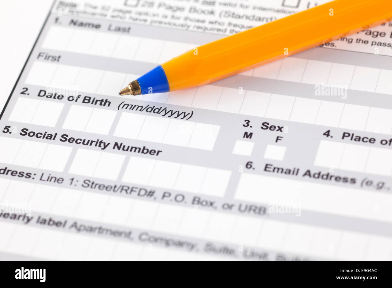 Application form with ballpoint pen. Focus on date of birth and social security number. - Stock Image