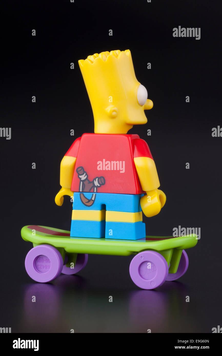 Tambov, Russian Federation - April 30, 2014 Lego Bart Simpson minifigure back view on skateboard on black background. - Stock Image