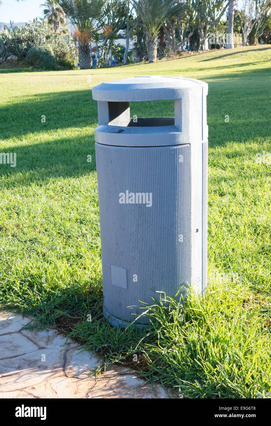Outdoor gray empty garbage can - Stock Image