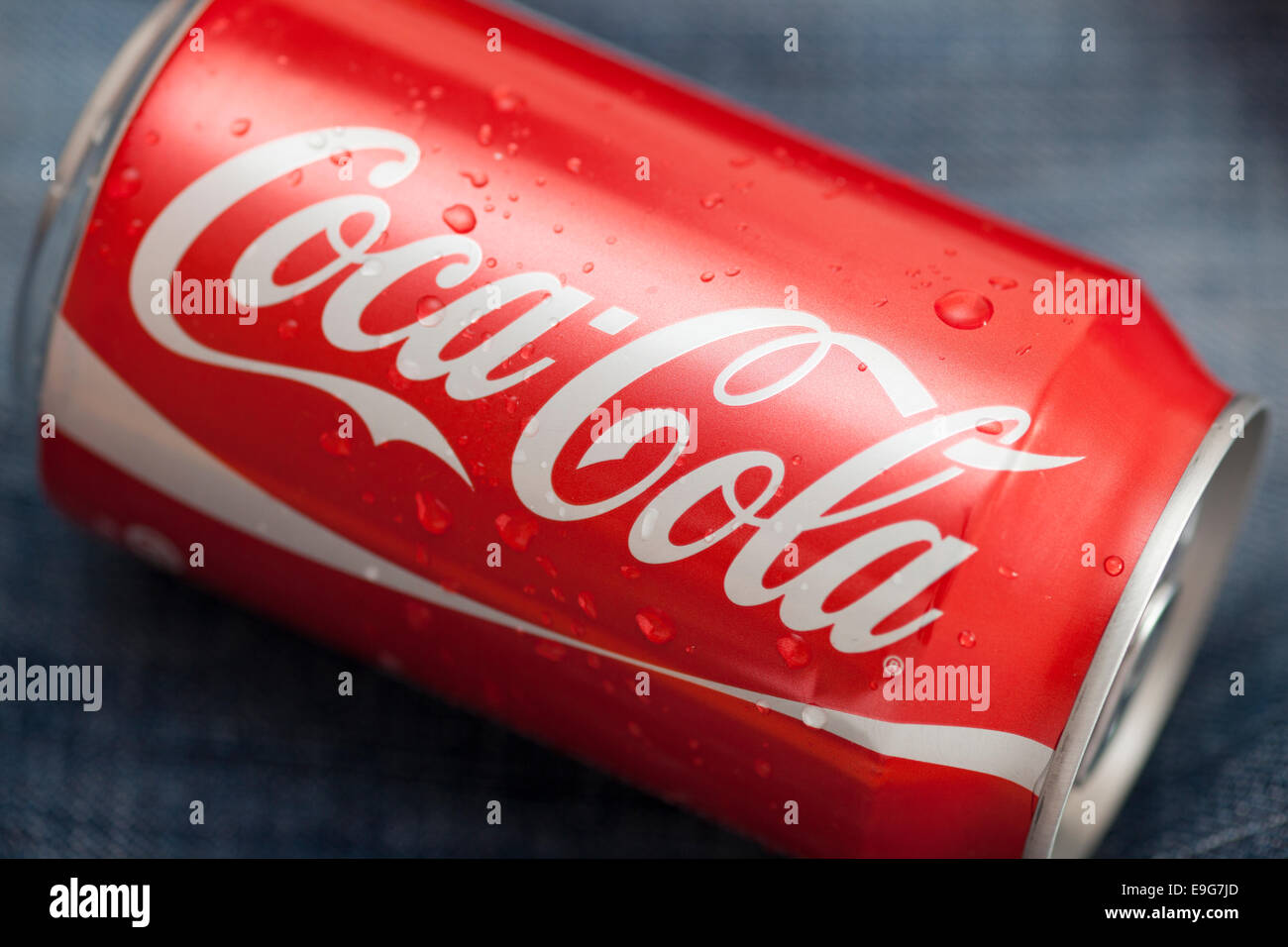 Tambov, Russian Federation - March 14, 2011 Coca-Cola can with water droplets on denim background. Studio shot. - Stock Image