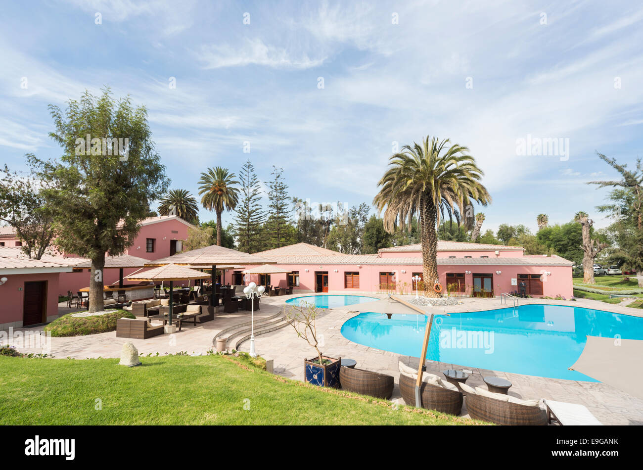 Gardens of Hotel Libertador, Arequipa, Peru, with blue swimming pool and palm trees - Stock Image