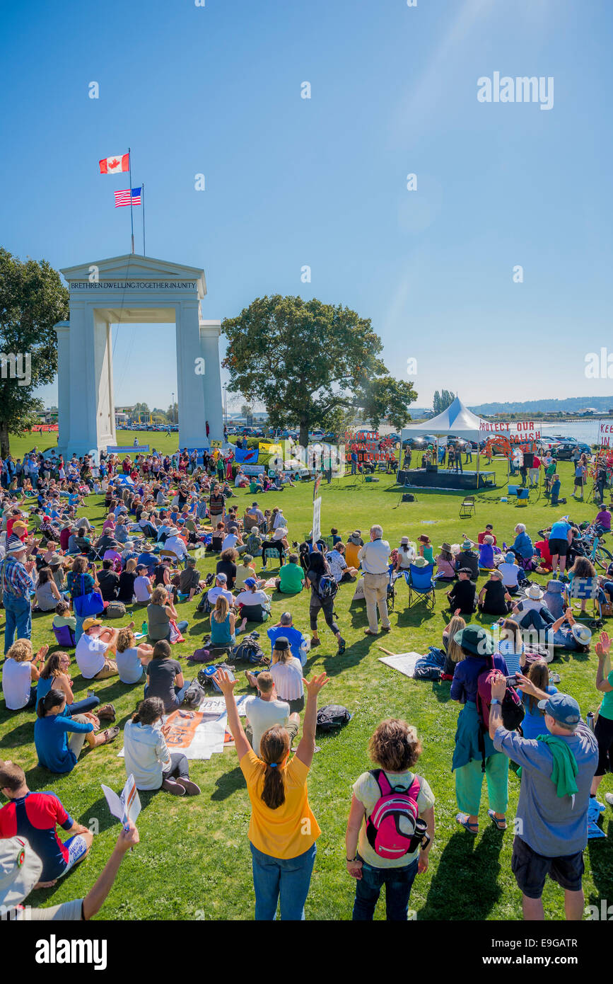 Climate Change Knows No Borders. International rally at Peace Arch U.S.A  Canada border crossing. - Stock Image