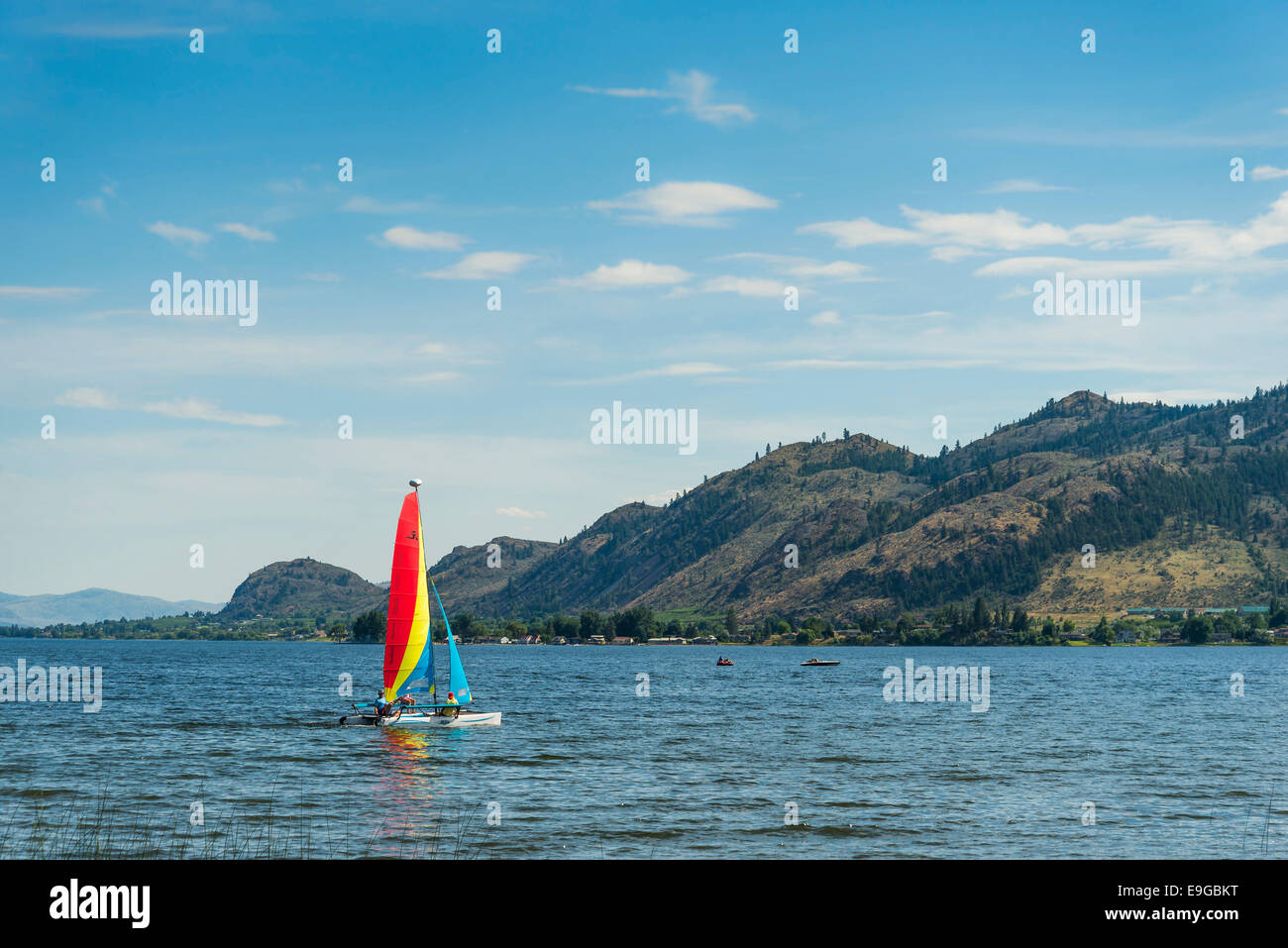 Catamaran sailboat on Osoyoos Lake, Osoyoos, ,  British Columbia, Canada - Stock Image